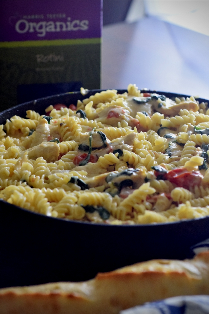 This organic chicken spinach pasta recipe is an easy dinner for those busy nights and a family favorite dinner recipe!  Make this chicken spinach pasta in about 30 minutes and dinner is done!